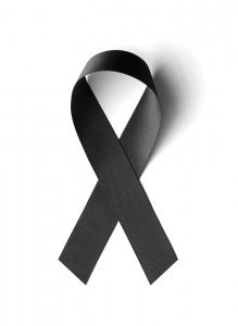 shutterstock_156724085 - grief black ribbon